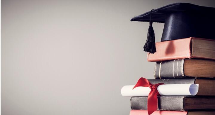 Graduation cap on top of books