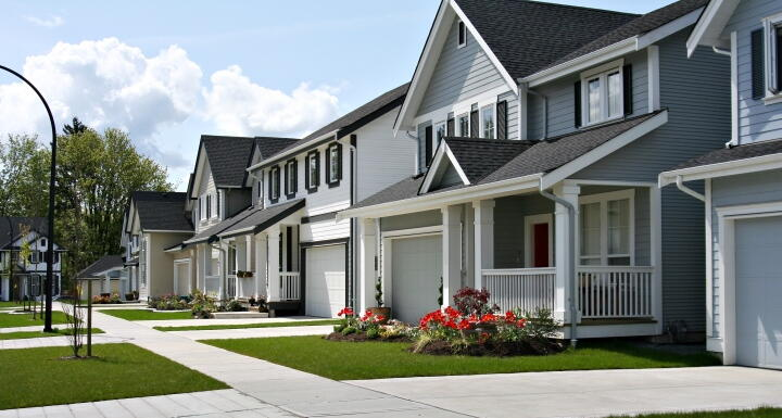 Row of gray houses in a neighborhood