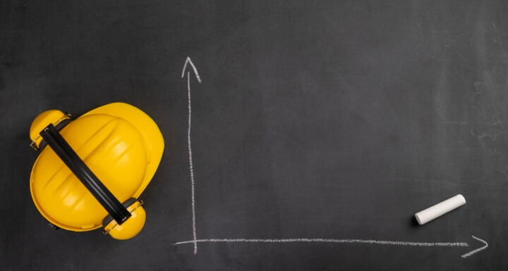 Hard hat on chalkboard with blank chart drawing