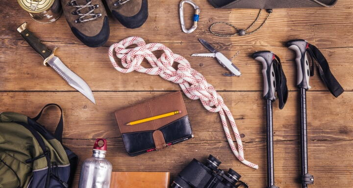Hiking equipment include hiking boots, knife, walking poles, rope, backpack