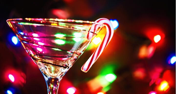 Martini glass with holiday lights and candy cane