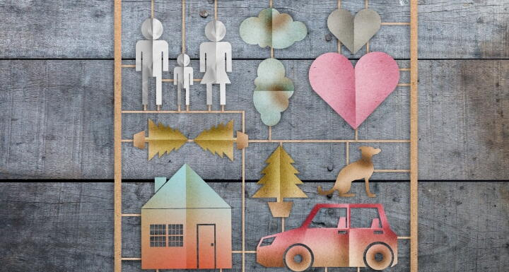 Cutouts of people, clouds, hearts, trees, house, car, and dog affixed on to wooden square