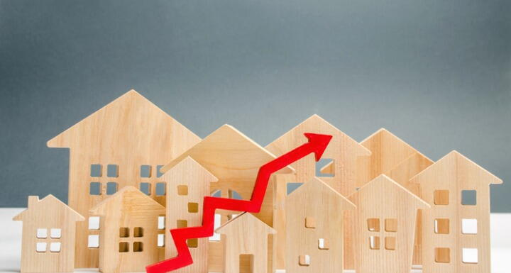Multiple Wooden Home cutouts with red up arrow