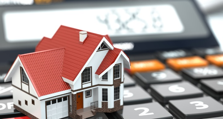 Rendering of house on top of a calculator