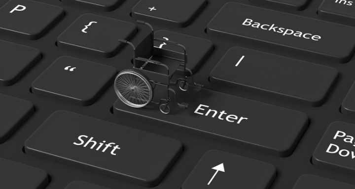 Black wheelchair on a black keyboard with white letters