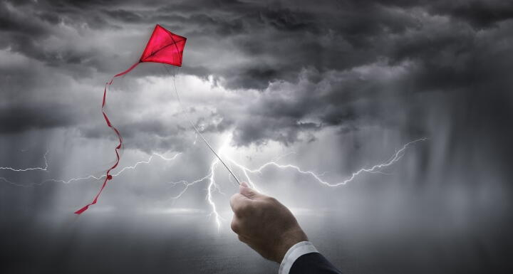 Kite flying in storm with lightning