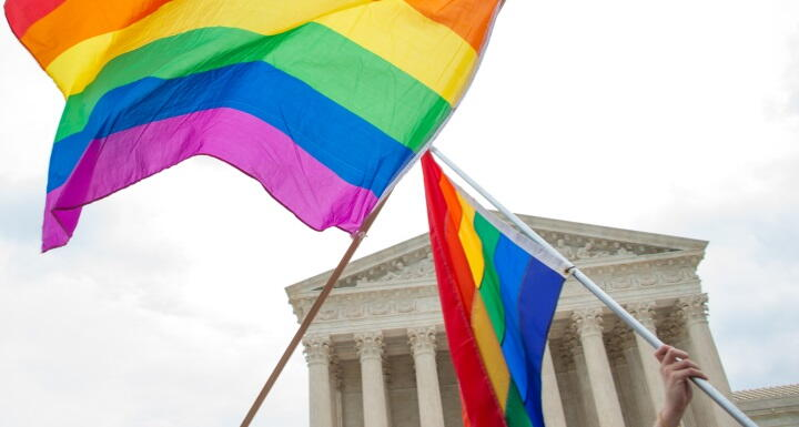 LGBTQ rainbow flag flying in front of Supreme Court building