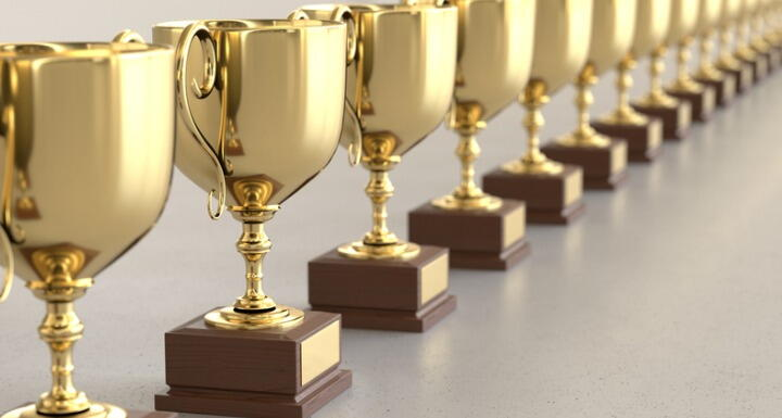 Linary array of gold trophies