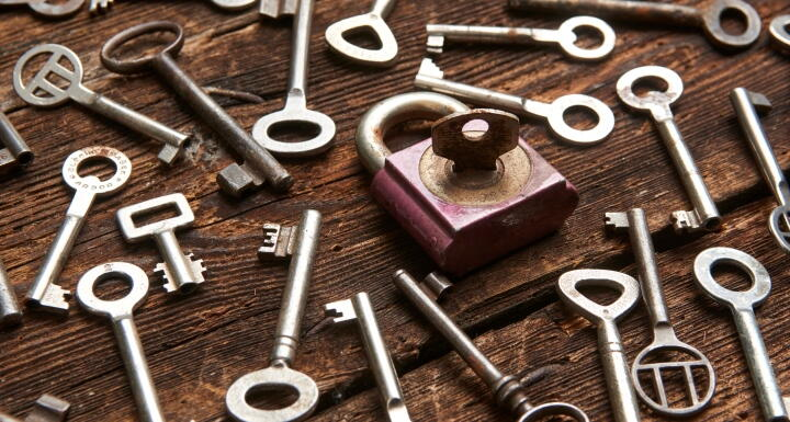 arrangement of old fashioned keys surrounding one old lock