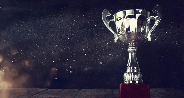 Silver trophy on black background