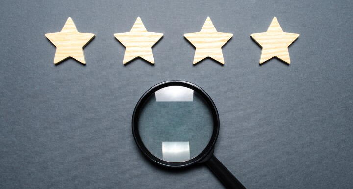 Four stars over a magnifying glass