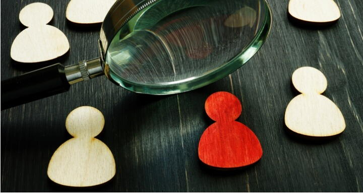 Magnifying Glass and Wooden Figures