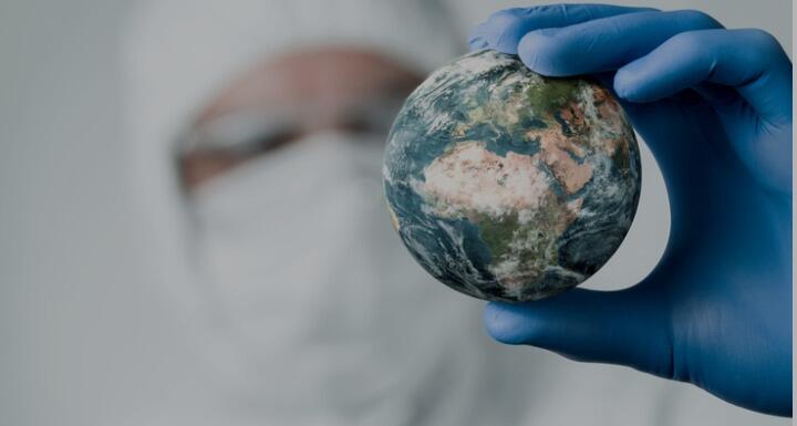 Main in lab coat inspecting world