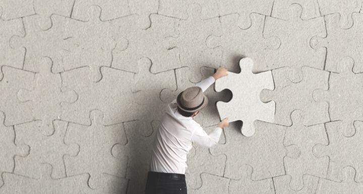 Man placing last puzzle piece
