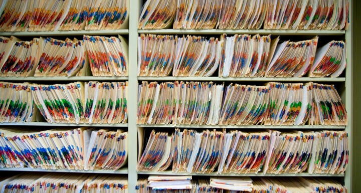 Shelves full of medical records and patient charts