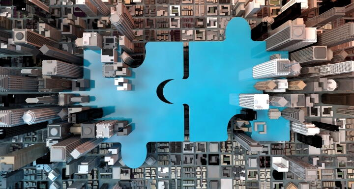 Giant blue puzzle pieces coming together in a city block