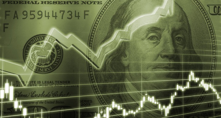 Green 100 bill with stock market graphs overlaid in front of the bill