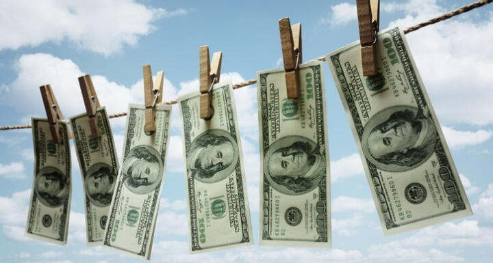 Money hanging outside on laundry wire