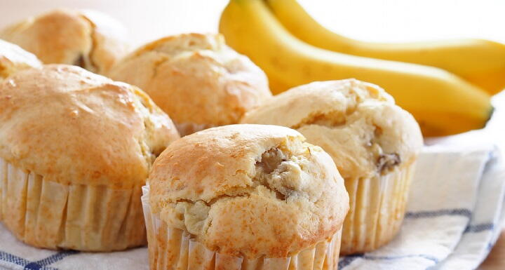 A selection of bananas and muffins on a kitchen towel