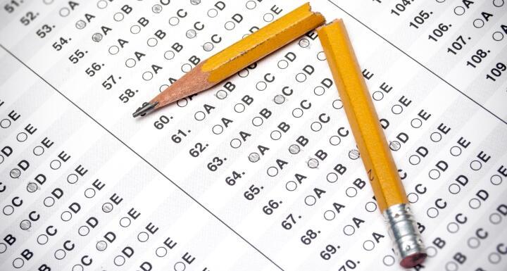 A bubble answer sheet and a broken pencil
