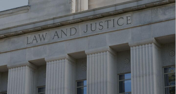 Close up shot on the words Law and Justice on NC Courthouse