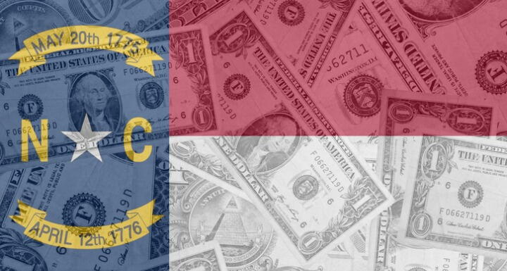 NC Flag superimposed over money