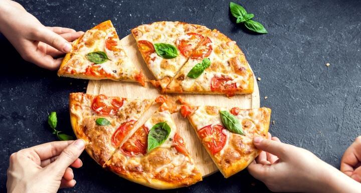 A pizza sliced six ways.