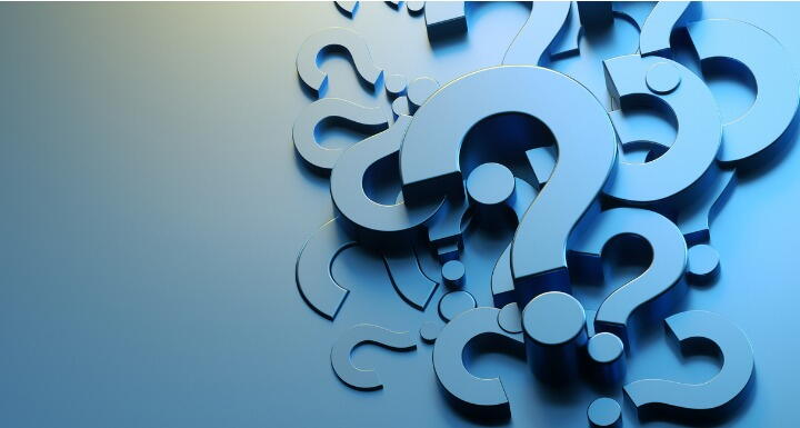 Blue cut outs of question marks arranged in an artful pile