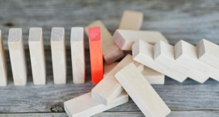 Red domino stops falling dominos