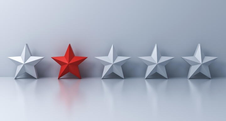 A red star stands out among silver stars