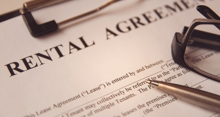 Printed Rental Agreement on a Clipboard