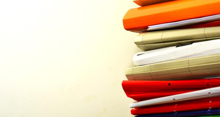 Stack of file folders on a desk