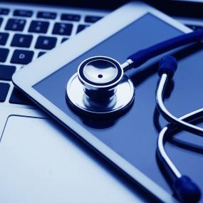 Stethoscope on Tablet on keyboard