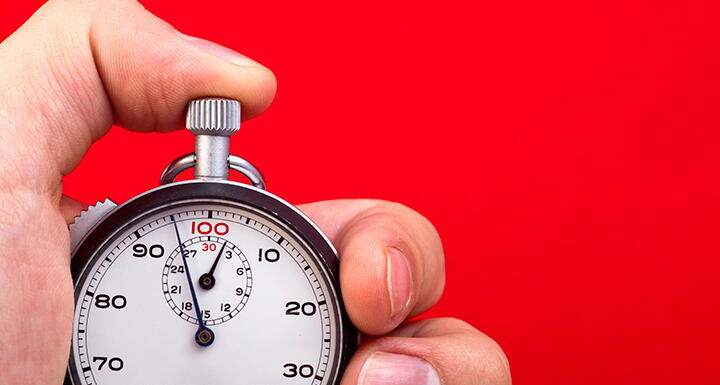 Thumb on stop watch button with red background