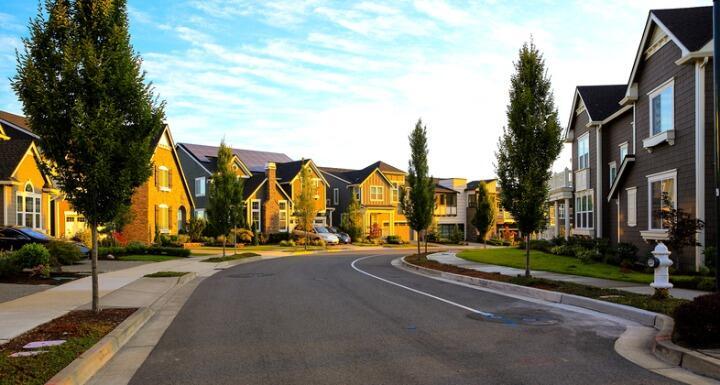 Neighborhood of homes with sun shining on the homes