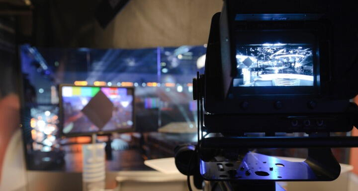 View of television studio through camera lens