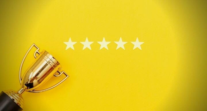 Trophy with Five Stars on Yellow Background