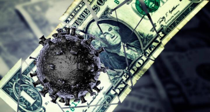 Illustration of a virus on top of a dollar bill
