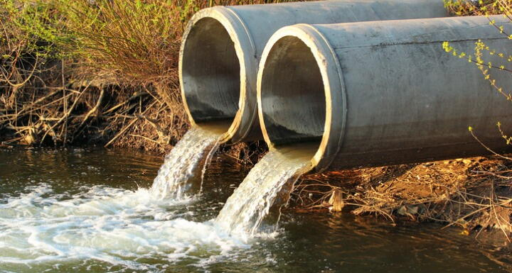 Two cement water pipes discharging water