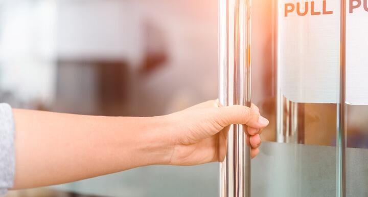 Woman pulling on door handle