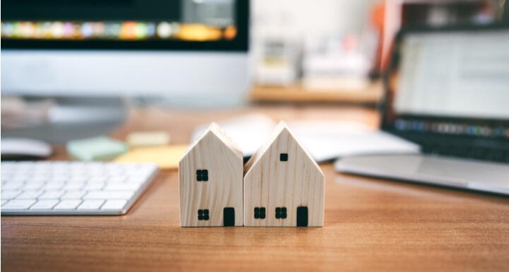 Wooden house model with workplace table