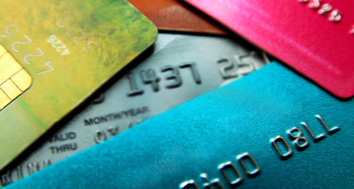 a colorful collection of credit cards in a pile