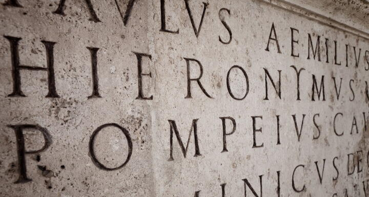 A stone carving of latin words