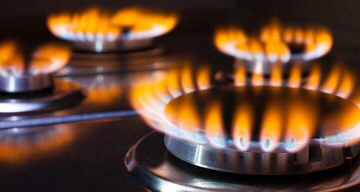 Lit gas burners on a hot stove