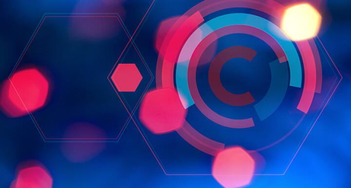 Copyright symbol in pink on blue background surrounded by abstract pink lights