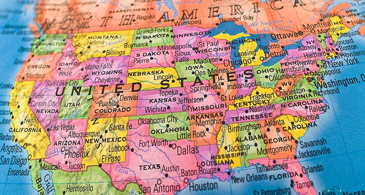 Globe view of the United States with states colored in yellow pink orange and green