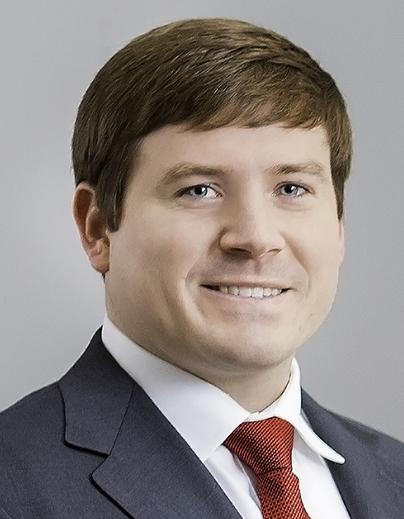 Tyler J. Russell