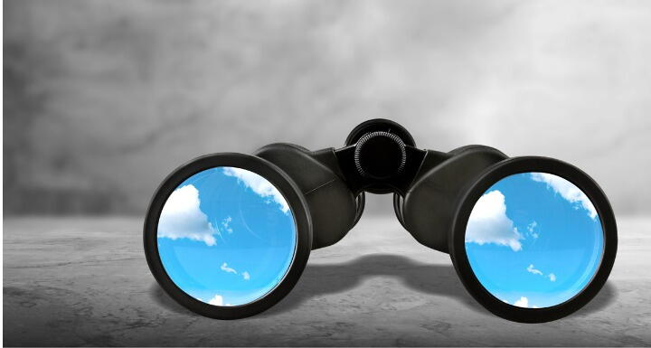 Binoculars with blue sky lens on a gray background