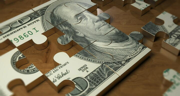 Dollar bill as puzzle pieces