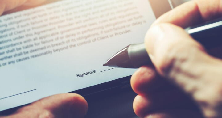 man sign distance contract with digital pen in mobile phone